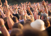 crowd of people with hands up