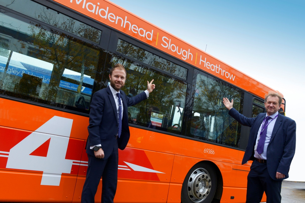 Simon Goff (L), First Berkshire's Head of Operations and Matthew Wooll, Heathrow Airport's Route Development Lead, Surface Access admiring the first bus with the new Service 4 livery