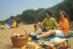 couple having a picnic on Burnham beach
