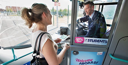 woman paying for ticket on first bus