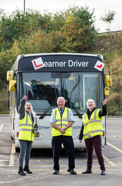 First Bus newly qualified driver Donna Scullion left and trainee Marie Robertson right with trainer Ian McFadden