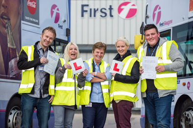 First Glasgow newly qualified drivers Darius Smulkstys and Donna Scullion, examiner Linda McNeish , trainee driver Marie Robertson, newly qualified driver Adam Bulloch.