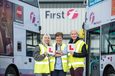 First Glasgow newly qualified drivers Donna Scullion left andMarie Robertson right with examiner Linda McNeish