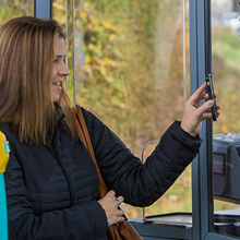 Woman using the mTickets App