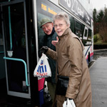 elderly couple boarding first bus potteries