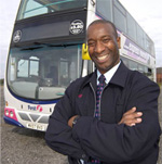 man stood in front of first double decker bus