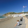 people sitting on aberystwyth beach