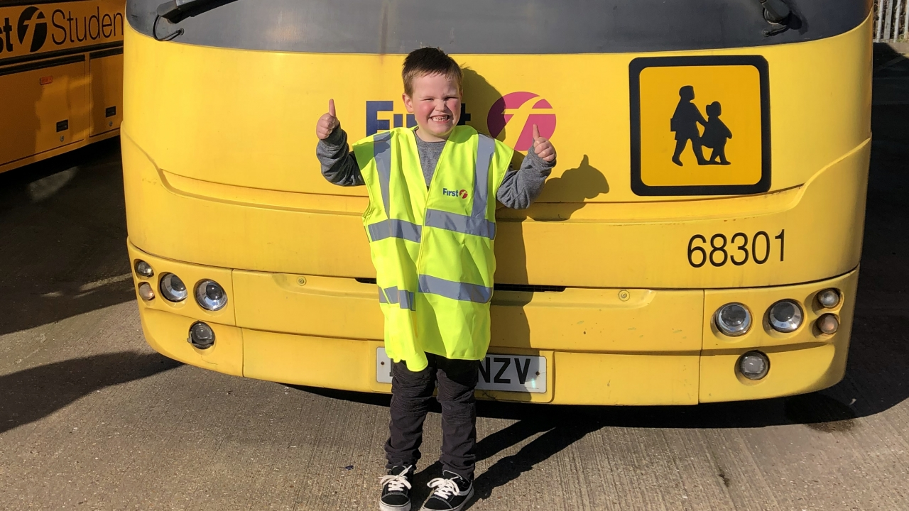 Alfie poses in front of one of many buses at City Red's Southampton bus depot