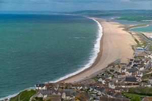 Visit picturesque Chesil Beach, which stretches from Portland to West Bay Harbour